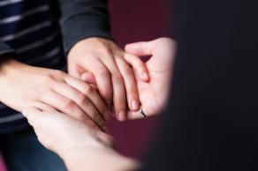 feminine-hand-holding_925x